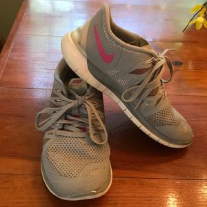 Nike Free 5.0 athletic shoes